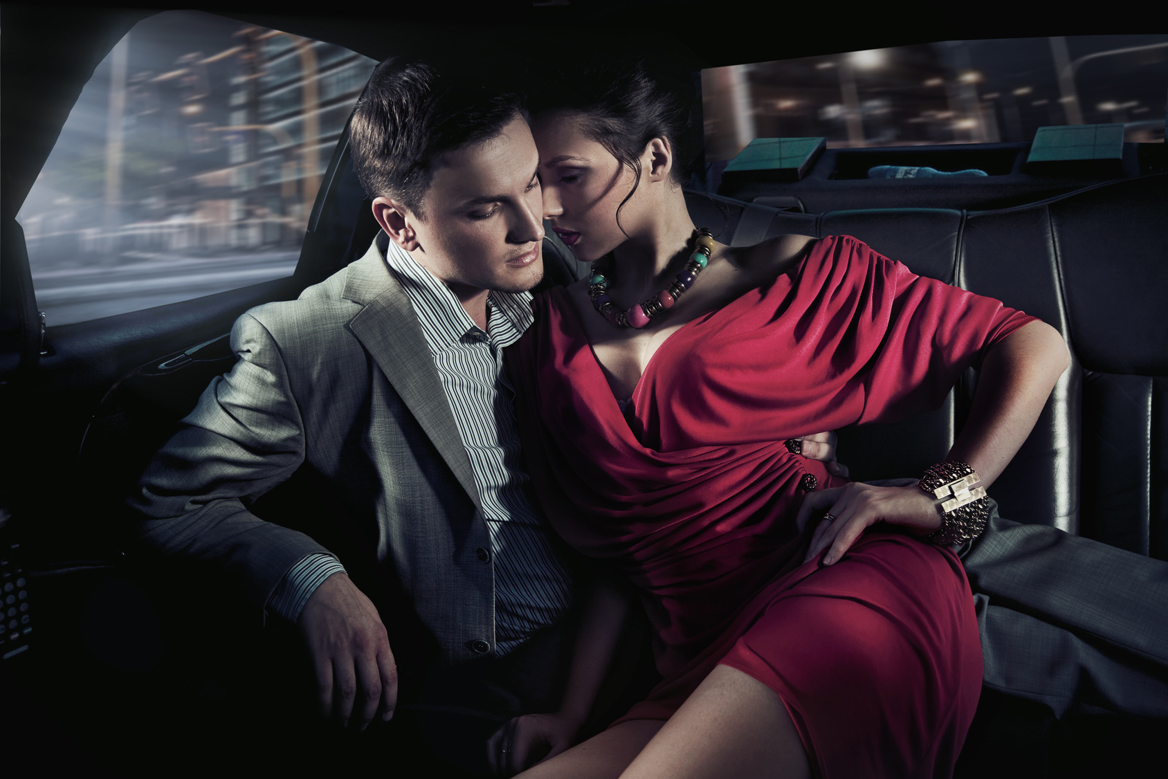 Sexy sitting couple in car